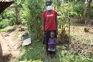 The Water Project: Khunyiri Community, Edward Spring -  Alice With Child