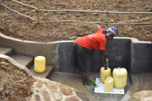 The Water Project: Khunyiri Community, Edward Spring -  Filling Jerrycans