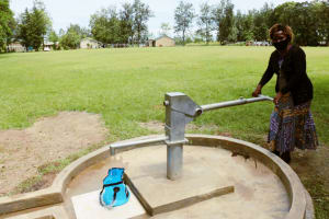 The Water Project: Yathui Community A -  Teacher Collects Water