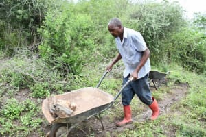 The Water Project: Yathui Community A -  Moving Stone