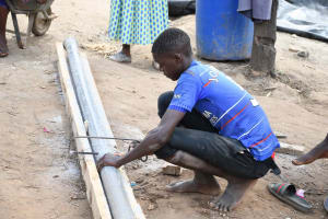 The Water Project: Yathui Community A -  Sawing Pipe