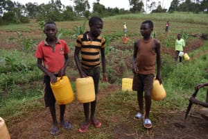 The Water Project: Chimoroni Community, Maurice Luta Spring -  Collecting Water