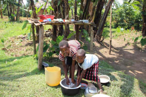 The Water Project: Shiana Community, Masiache Spring -  Children Washing Dishes