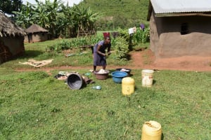 The Water Project: Mungakha Community, Mungakha Spring -  Caroline Washing Her Clothes
