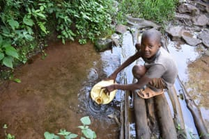 The Water Project: Mungakha Community, Mungakha Spring -  Pharel Fetching Water