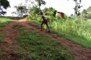 The Water Project: Mungakha Community, Mungakha Spring -  Pharel Carrying Water