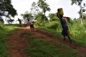 The Water Project: Mungakha Community, Mungakha Spring -  Carrying Water