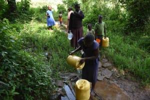 The Water Project: Mungakha Community, Mungakha Spring -  Communuity Members Waiting For Water