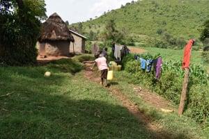 The Water Project: Mungakha Community, Mungakha Spring -  Children Carrying Water