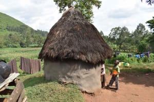 The Water Project: Mungakha Community, Mungakha Spring -  Outside Traditional Kitchen
