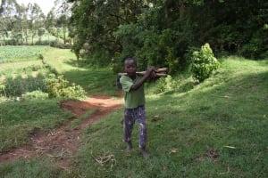 The Water Project: Mungakha Community, Mungakha Spring -  Boy With Farm Tools