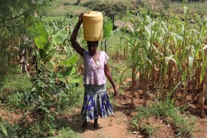 The Water Project: Makunga Community, Akinda Spring -  Hellen Carrying Water