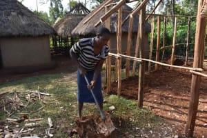 The Water Project: Makunga Community, Akinda Spring -  Hellen Splitting Firewood