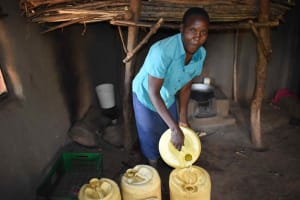 The Water Project: Makunga Community, Akinda Spring -  Hellen Storing Water In Containers