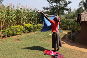The Water Project: Makunga Community, Akinda Spring -  Joan Hanging Clothes