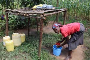 The Water Project: Makunga Community, Akinda Spring -  Joan Washing Dishes