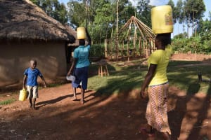 The Water Project: Makunga Community, Akinda Spring -  People Carrying Water