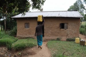 The Water Project: Makunga Community, Malaha Spring -  Elvine Carrying Water