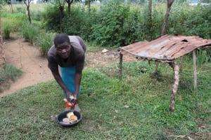 The Water Project: Makunga Community, Malaha Spring -  Elvine Washing Dishes