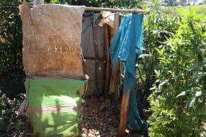 The Water Project: Emulele Community, Fanice Opati Spring -  Bathroom