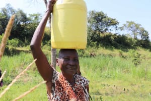 The Water Project: Emulele Community, Fanice Opati Spring -  Carrying Water