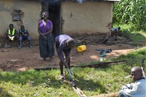 The Water Project: Isembe Community, Mangala Spring -  Splitting Firewood
