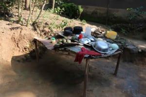 The Water Project: Isembe Community, Mangala Spring -  Dishrack