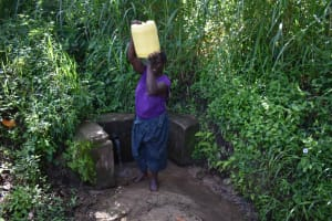 The Water Project: Isembe Community, Mangala Spring -  Tecla Carrying Jerrycan