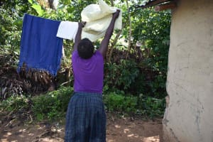 The Water Project: Isembe Community, Mangala Spring -  Tecla Hanging Clothes