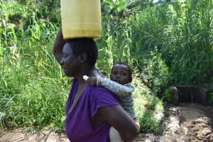 The Water Project: Isembe Community, Mangala Spring -  Tecla Walking Home