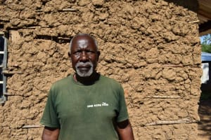 The Water Project: Isembe Community, Inyende Spring -  Marko Outside Home