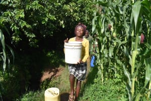 The Water Project: Isembe Community, Inyende Spring -  Sharon Adjusting Heavy Bucket