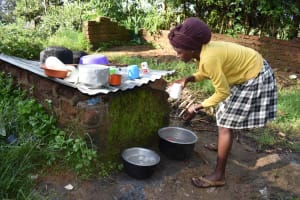 The Water Project: Isembe Community, Inyende Spring -  Sharon Doing Dishes