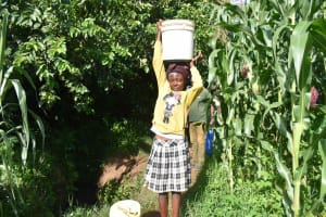 The Water Project: Isembe Community, Inyende Spring -  Sharon Fetching Water
