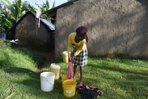 The Water Project: Isembe Community, Inyende Spring -  Sharon Washing Clothes