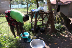 The Water Project: Isembe Community, Inyende Spring -  Washing Dishes