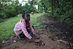 The Water Project: Emaongoyo Community, Philip Mwando Spring -  Child Playing
