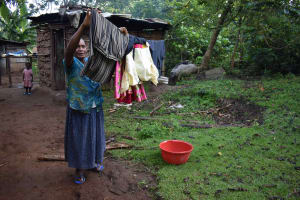 The Water Project: Emaongoyo Community, Philip Mwando Spring -  Julia Hanging Clothes