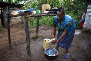The Water Project: Emaongoyo Community, Philip Mwando Spring -  Julia Washing Dishes