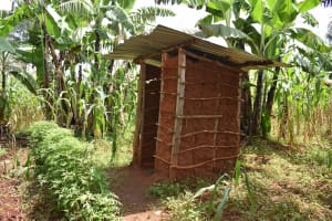 The Water Project: Lunyinya Community, Steven Shitundo Spring -  Latrine Made Of Mud Walls