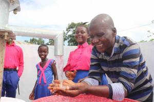 The Water Project: Masoila Roman Catholic Primary School -  Alex Dawo With Students
