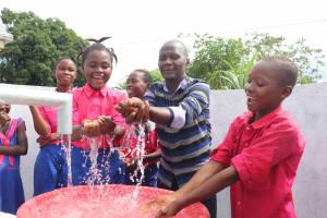 The Water Project: Masoila Roman Catholic Primary School -  Head Teacher With Students