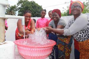 The Water Project: Masoila Roman Catholic Primary School -  Community Members At Well