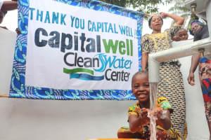 The Water Project: Lokomasama, Kalangba Junction, Next to Alimamy Musa Kamara's House -  Kid Happily Drinking Water