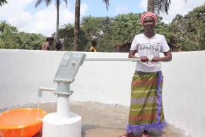 The Water Project: Lokomasama, Kalangba Junction, Next to Alimamy Musa Kamara's House -  Woman Happily Collecting Water