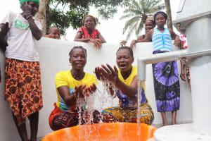 The Water Project: Lokomasama, Kalangba Junction, Next to Alimamy Musa Kamara's House -  Women Splashing Water