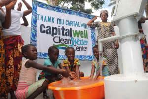 The Water Project: Lokomasama, Kalangba Junction, Next to Alimamy Musa Kamara's House -  Kids Happily Splashing