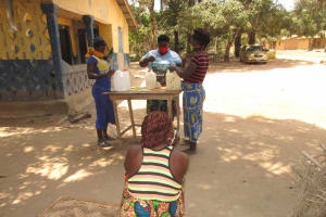 The Water Project: Lokomasama, Kalangba Junction, Next to Alimamy Musa Kamara's House -  Participants Constructing Tippy Tap