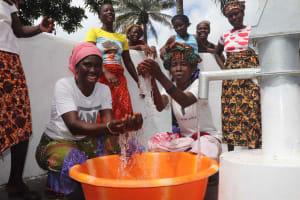 The Water Project: Lokomasama, Kalangba Junction, Next to Alimamy Musa Kamara's House -  Women Joyfully Splashing