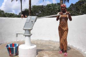 The Water Project: Lokomasama, Kalangba Junction, Next to Alimamy Musa Kamara's House -  Young Lady Collecting Water